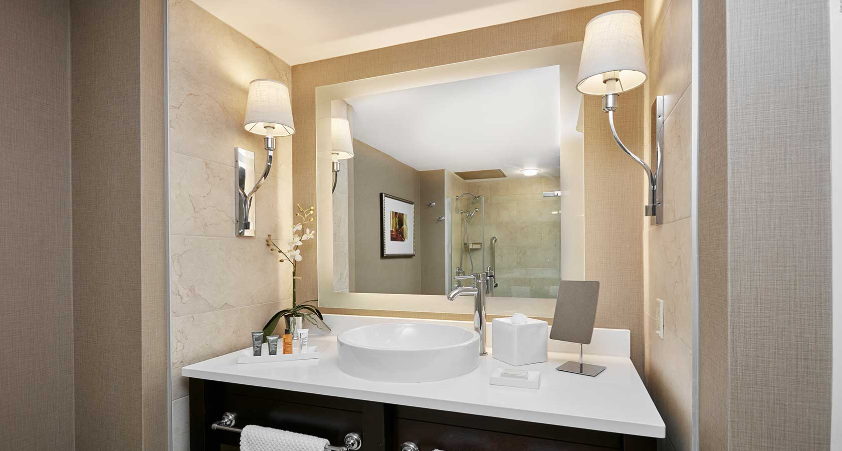 Newly renovated bathroom with a glass enclosed stall shower